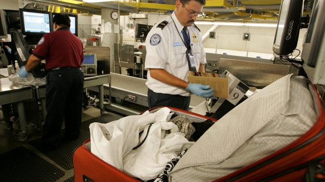 OAKLAND, CA - JUNE 22: A Transportation Security Administration (TSA) worker hand searches a bag at the Oakland International Airport June 22, 2006 in Oakland, California. The TSA is using a brand new $16.4 million dollar in-line explosive detection system at Oakland International Airport which allows checked luggage to be screened much faster than the previous methods. Baggage screeners can now scan up to 1,000 bags per hour up from 250 per hour. (Photo by Justin Sullivan/Getty Images)