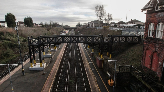 Article thumbnail: A deserted Hunt's Cross railway station in Liverpool as workers at Merseyrail workers went on strike over staffing last year, causing travel misery for passengers. (Photo: Peter Byrne/PA Wire)