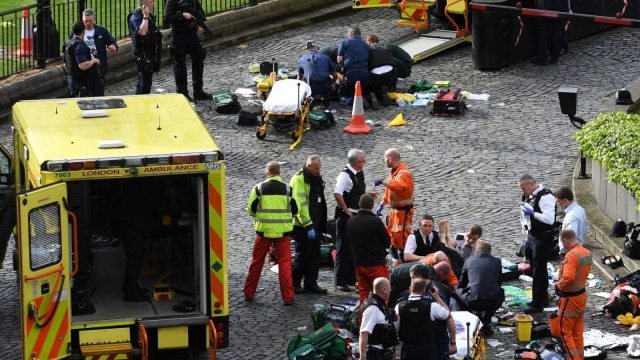 Emergency services at the scene outside the Palace of Westminster, London, after a policeman was stabbed and his apparent attacker shot by officers in a terrorist incident (Photo:PA)