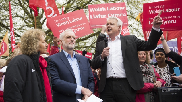 First Minister of Wales Carwyn Jones introduces Labour leader Jeremy Corbyn at a rally in Cardiff last week. A new poll suggests Labour could lose two seats in the Welsh capital on 8 June amid a surge in Conservative support. (Photo by Matthew Horwood/Getty Images)