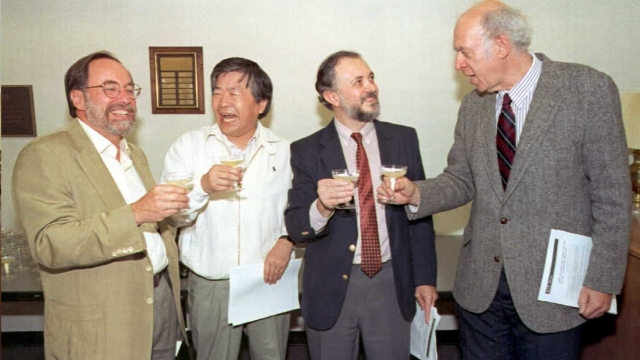 Professor Susumu Tonegawa (second left), who specialises in neuroscience, pictured celebrating his Nobel prize win for chemistry with MIT colleagues in 1987.