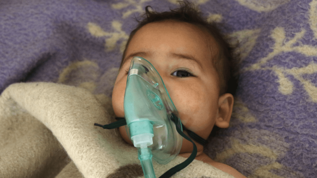 A child receives treatment at a small hospital in the town of Maaret al-Noman following a suspected toxic gas attack in Khan Sheikhun