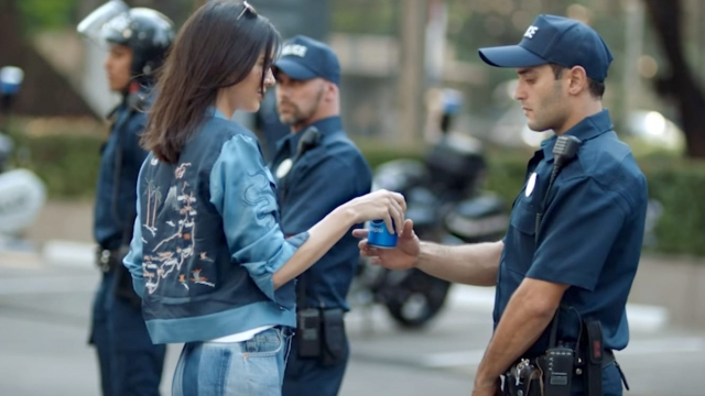If only all protests had supermodels bearing Pepsi to save the day