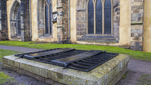 An iron cage (known as a mortsafe) covering a grave in Greyfriars Cemetery in Edinburgh