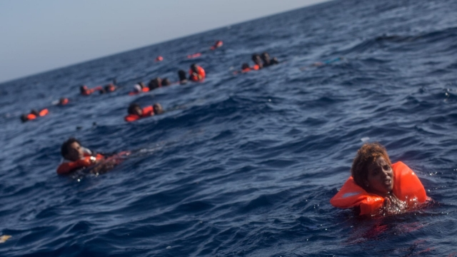 People shout for assistance after a boat carrying more than 500 migrants capsized off Lampedusa (Photo: Getty)