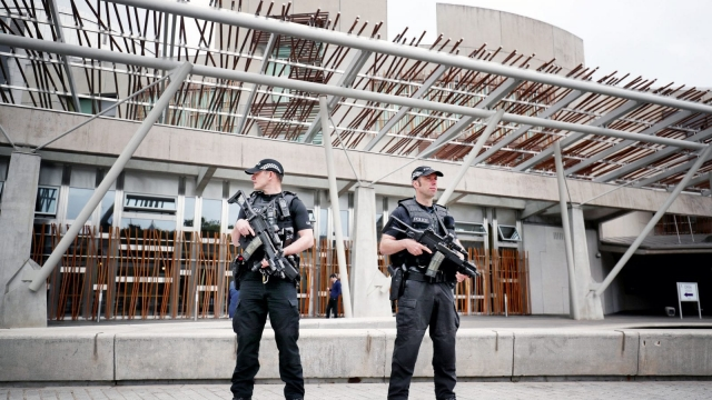 Armed police on patrol outside the Scottish Parliament in Edinburgh on Wednesday (Photo: PA)