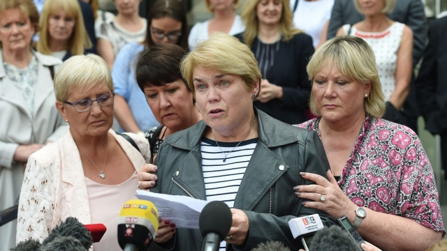 Victim Patricia Welch (centre) reads a statement alongside Judith Conduit (left) and Frances Perks (right) outside leave Nottingham Crown Court where surgeon Ian Paterson was jailed for 15 years after he carried out a raft of needless breast operations, leaving his victims scarred and disfigured.