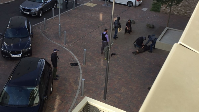 An image of an arrest taking place during the raid in Barking