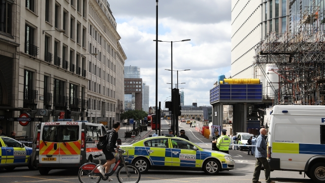 Police operate a cordon on the North side of London Bridge as forensic officers work after Saturday's terrorist attack