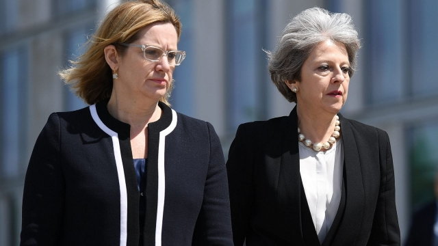 MANCHESTER, ENGLAND - MAY 23: Home Secretary Amber Rudd and Britain's Prime Minister Theresa May (R) make their way to meet Chief Constable of Greater Manchester Police Ian Hopkins on May 23, 2017 in Manchester, England. Prime Minister Theresa May held a COBRA meeting this morning following a suicide attack at Manchester Arena as concert goers were leaving the venue after Ariana Grande had performed. Greater Manchester Police have confirmed the explosion as a terrorist attack with 22 fatalities and 59 injured. (Photo by Leon Neal/Getty Images)