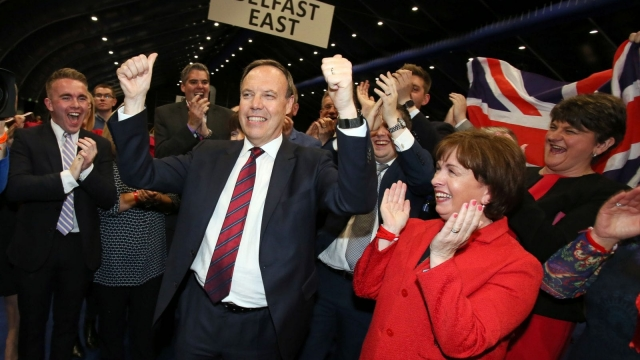 DUP deputy leader Nigel Dodds (C) celebrates winning his Belfast North seat with leader Arlene Foster (r) (Picture: Getty Images)