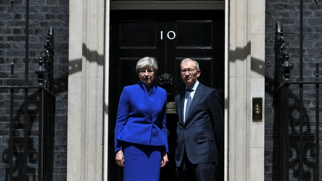 Theresa May and husband Philip return to Downing Street after the scale of her election miscalculation becomes clear. (Photo: Getty)