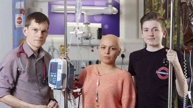 Consultant Haematologist Dr Nick Heaney with teenage cancer patients Natasha McNeil and Nairn Archer (Photo: BBC)