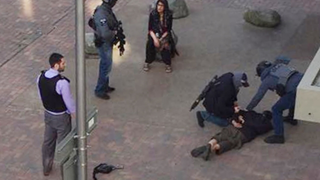 One person (right) is detained by police in Barking, east London, following the terror attack on London Bridge