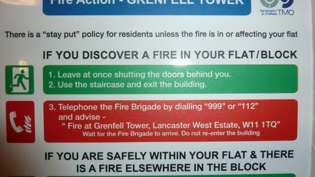"""Signs in hallways and lifts told Grenfell tower block residents that if a fire broke out they would be """"initially safe"""" in their flats. photo: Grenfell Action Group."""