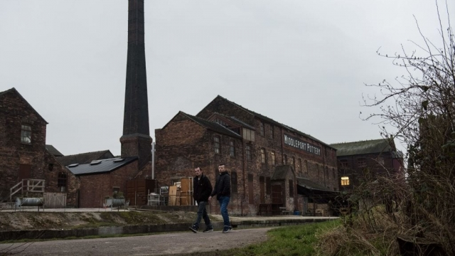 Men walk along a canal path past the site of Middleport Pottery near Tunstall in Stoke-on-Trent. (Photo: Oli Scarff/AFP/Getty Images)