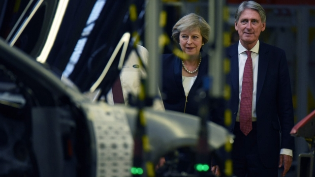 Potentially cofusing: Philip Hammond and Theresa May view a car production line. Photo: Getty