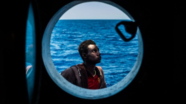 A refugee is rescued from a boat sailing out of control in the Mediterranean Sea, near Libya last month. Hundreds of refugees are rescued every day from dangerous boats supplied by people smugglers. (Photo: Getty Images)
