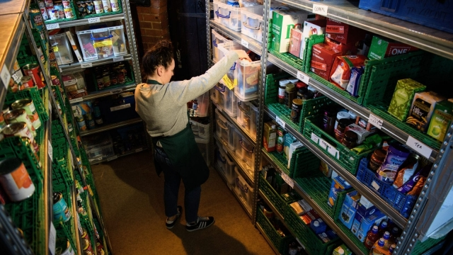 A volunteer at a foodbank prepares food parcels (Photo by Leon Neal/Getty Images)