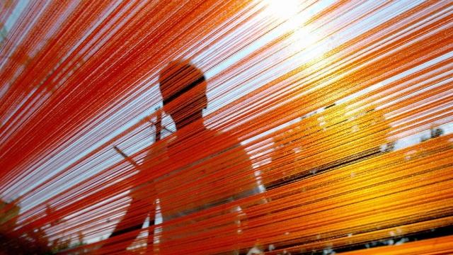 Silk weaving in India. (Photo: Dibyangshu Sarkar/AFP/Getty Images)