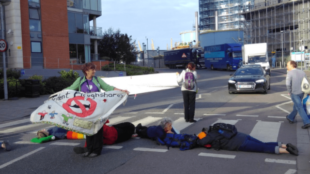 Campaigners blockade the Road at the ExCel centre. (Photo: Trident Ploughshares)