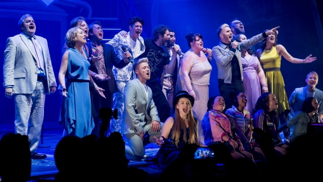 Mark Owen, Howard Donald and Gary Barlow join the cast of 'The Band' on stage. Photo: Matt Crockett