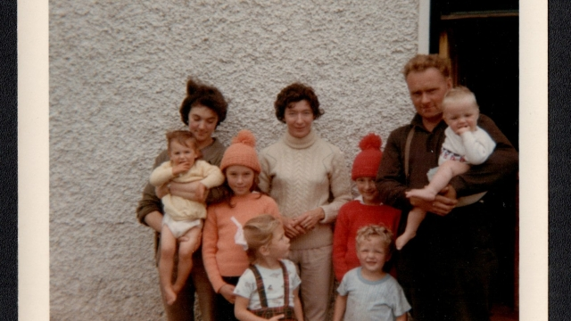 Clair Wills: 'My mother (in the centre) and my aunt and uncle outside my uncle's house near Skibbereen. I'm the one in the kilt.'