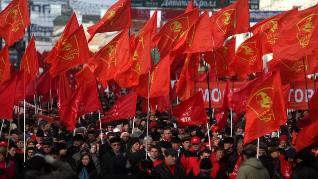 Russian communist party supporters mark the anniversary of the 1917 Bolshevik revolution by carrying flags through Moscow, as seen here in 2010