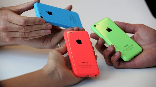 CUPERTINO, CA - SEPTEMBER 10: The new iPhone 5C is displayed during an Apple product announcement at the Apple campus on September 10, 2013 in Cupertino, California. The company launched the new iPhone 5C model that will run iOS 7 is made from hard-coated polycarbonate and comes in various colors and the iPhone 5S that features fingerprint recognition security. (Photo by Justin Sullivan/Getty Images)