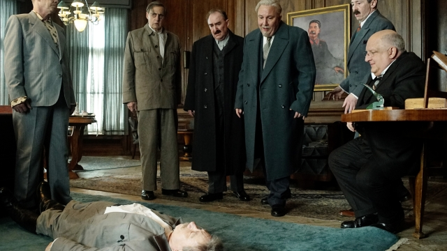 Steve Buscemi, Jeffrey Tambor, Dermot Crowley, Paul Chahidi, Paul Whitehouse and Simon Russell Beale confront a collapsed Stalin (Adrian McLoughlin)