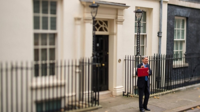 Chancellor Philip Hammond holding his red ministerial box outside 11 Downing Street, London, before heading to the House of Commons to deliver his Budget (Photo: PA)
