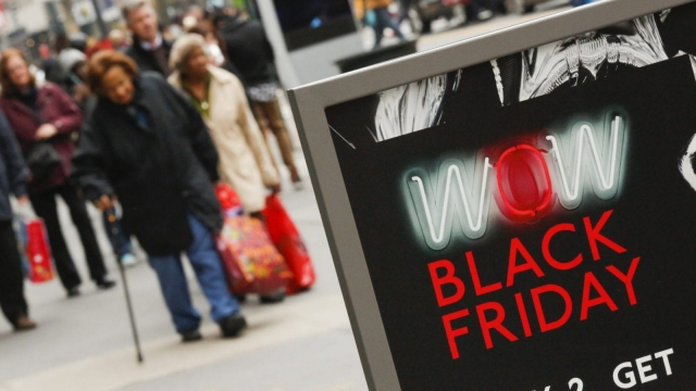 NEW YORK, NY - NOVEMBER 25: People carry retail shopping bags during Black Friday events on November 25, 2016 in New York City. The day after Thanksgiving, called Black Friday, is typically the biggest shopping day of the year in the United States. (Photo by Eduardo Munoz Alvarez/Getty Images)