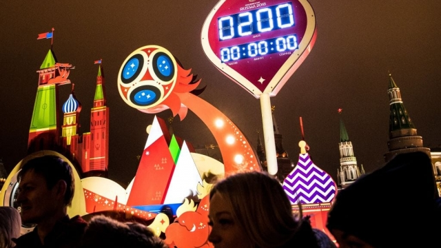 Fans watch the World Cup countdown clock outside the Kremlin in Moscow (Photo: Getty)