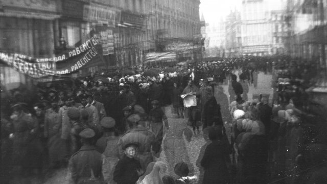 Soldiers and civilians march in the streets of Petrograd in 1917, photographed by Vera Hourwich