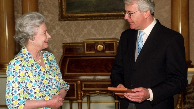 "Prime Minister Major rushed out the news the Queen had agreed to pay income tax to deflect growing media criticism in the wake of the Windsor Castle fire in 1992 and the monarch's self-confessed ""annus horribilis"". (Photo: PA Wire)"