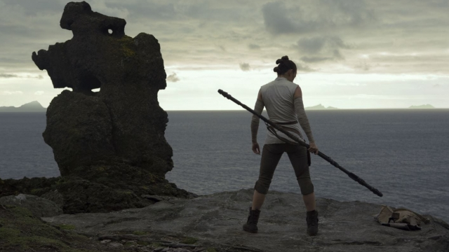 A screenshot of Rey, from Star Wars: The Last Jedi