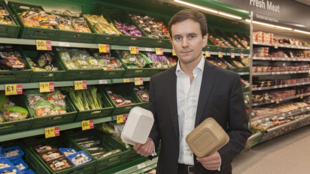 "Iceland's managing director, Richard Walker, with some non-plastic packaging, after they become the first major retailer to commit to eliminate plastic packaging for all own brand products within five years to help end the ""scourge"" of plastic pollution (PA)"