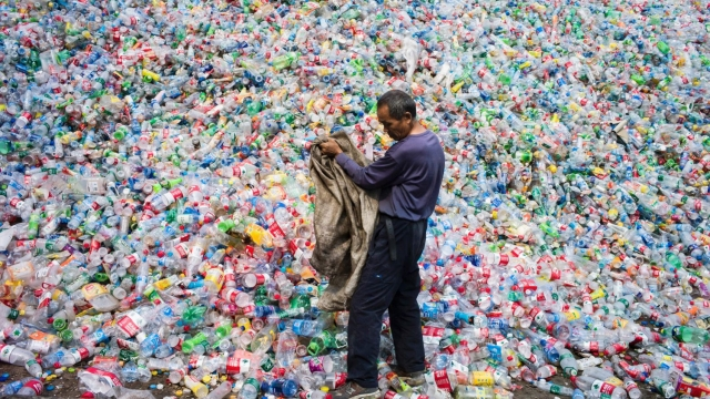 Chinese labourers sort out bottles for recycling in Beijing (Photo: Getty Images)