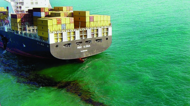 The MSC Ilona, a container ship registered in Germany, which was heading to Shanghai from the port of Shenzhen, near Hong Kong, is seen leaking oil from its fuel tanks into the South China sea after a collision in 2004