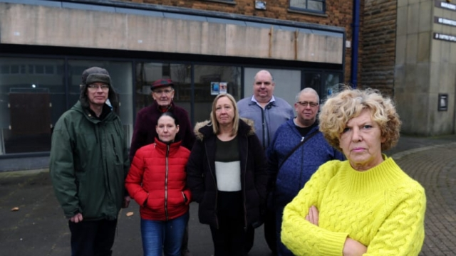 In Wath-upon-Dearne, near Rotherham, the village's four bank branches have already shut and it has had a major impact on the local community. Locals traders are up in arms about the closure. Pictured outside a boarded up Yorkshire Bank branch are Cate Ward with fellow traders and locals. (Photo: Jonathan Gawthorpe)