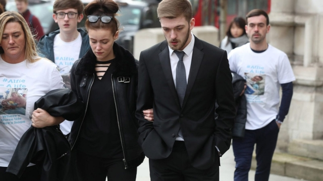 Article thumbnail: Tom Evans and Kate James, the parents of 21-month-old Alfie Evans, arriving at the High Court in London in February. (Jonathan Brady/PA Wire)