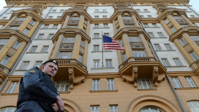 A Russian police officer patrols a street in front of the US Embassy in Moscow (Photo: Getty)