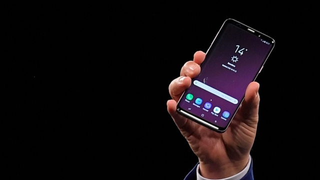 Samsung president of mobile communications business DJ Koh presents the new Samsung Galaxy S9 mobilephone during the Samsung Galaxy S9 Unpacked event on February 25, 2018 in Barcelona, on the eve of the inauguration of the Mobile World Congress (MWC). The Mobile World Congress, the world's biggest mobile fair, is held in Barcelona from February 26 to March 1. / AFP PHOTO / LLUIS GENE (Photo credit should read LLUIS GENE/AFP/Getty Images)