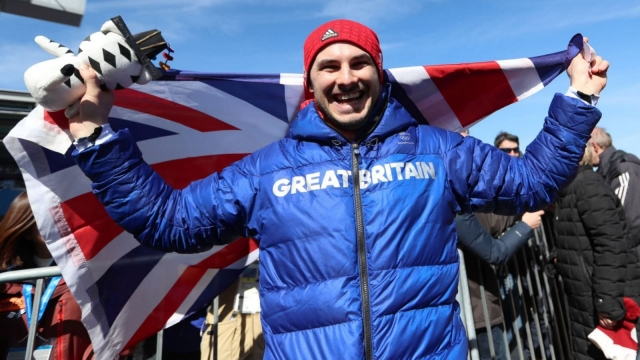 Study in bronze: Dom Parsons celebrates third place in the skeleton (PA)