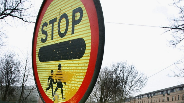 Two lollipop men have come under fire for high-fiving children. (Photo by Christopher Furlong/Getty Images)