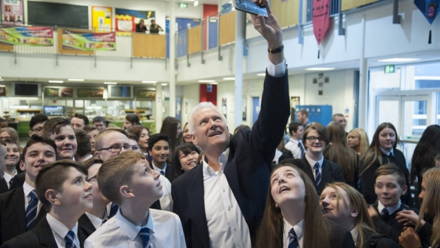 Brian McBride, the Asos chairman, with pupils at Smithycroft Secondary School in Glasgow (Photo: Martin Hunter)