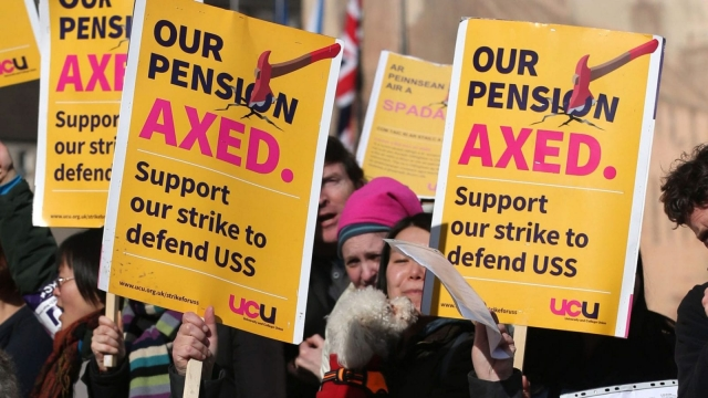 University staff on a strike in a dispute over pensions, as university employers have announced they will push ahead with a re-evaluation of the pension deficit at the heart of an industrial dispute with staff.