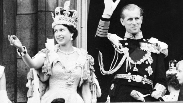 Queen Elizabeth II accompanied by Prince Philip waves to the crowd, 2 June 1953 after being crowned solemnly at Westminster Abbey (Photo: Getty)