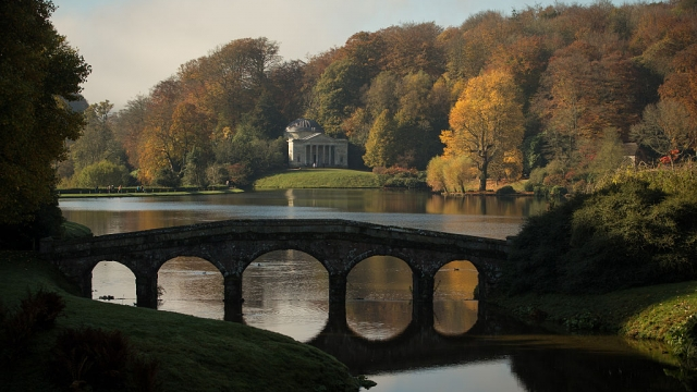 The Palladian bridge and the lakeside Pantheon at the National Trust's Stourhead garden in Wiltshire