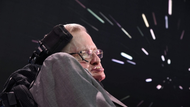 NEW YORK, NEW YORK - APRIL 12: Stephen Hawking, CH, CBE, FRS, Dennis Stanton Avery and Sally Tsui Wong-Avery Director of Research, University of Cambridge speaks on stage as he and Yuri Milner host press conference to announce Breakthrough Starshot, a new space exploration initiative, at One World Observatory on April 12, 2016 in New York City. (Photo by Bryan Bedder/Getty Images for Breakthrough Prize Foundation)